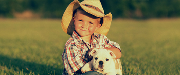 Boy with his dog on the farm